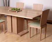 Bespoke Dining table and chairs in oak