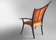 carved upholstered chair in rosewood and leather