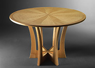 Round dining table in ripple sycamore